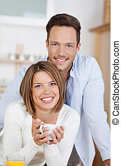 Happy couple with a cup of coffee