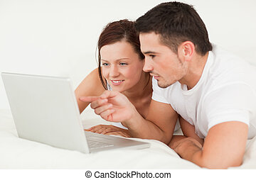 Happy couple with a laptop