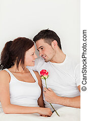 Happy couple with a rose