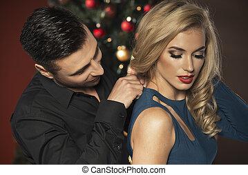 Happy Couple with Christmas tree