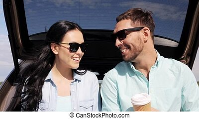 happy couple with coffee at hatchback car trunk 9 - travel,...