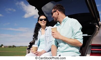 happy couple with coffee at hatchback car trunk 29 - travel,...
