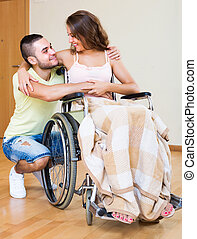 Happy couple with disabled spouse