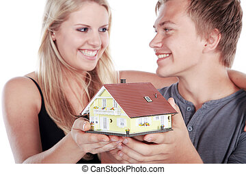 happy couple with dream house