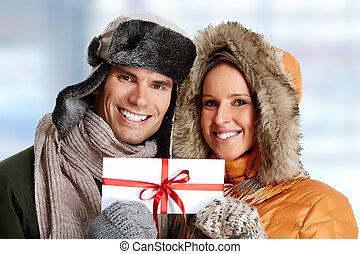 Happy couple with envelope.