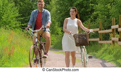 happy couple with fixed gear bicycles in summer