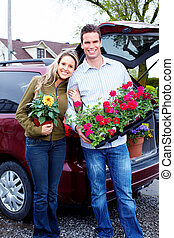 Happy couple with flowers.