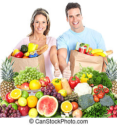 Happy couple with fruits. Isolated on white.
