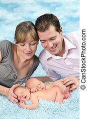 Happy couple with newborn twin babies
