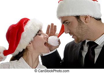 happy couple with red santa cap