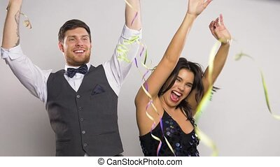 happy couple with serpentine party and having fun -...