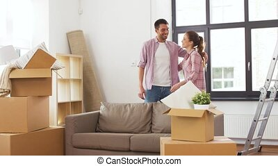happy couple with stuff moving to new home - accommodation,...