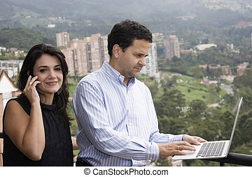 Happy couple working at home