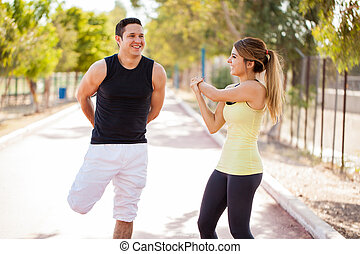 Happy couple working out together