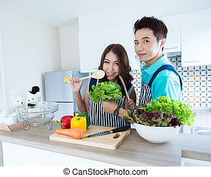 happy couples in kitchen