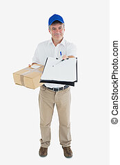 Happy courier man with package holding out clipboard