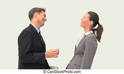 Happy coworkers laughing together against a white background