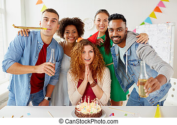 happy coworkers with cake at office birthday party -...