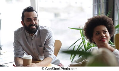 happy creative team with coffee talking in office -...