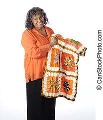 Happy Crocheter - A senior woman happily displaying her...