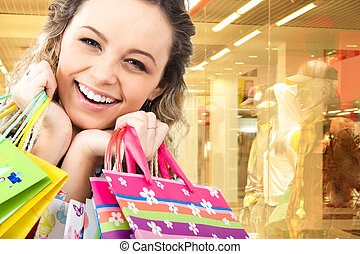 Happy customer - Close-up of cheerful woman�s face on the...