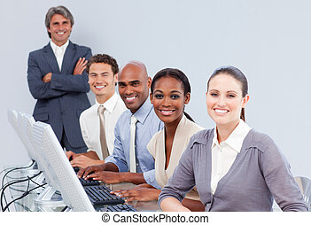 Happy customer service representatives using headset in a call-center