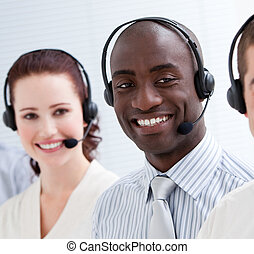 Happy customer service representatives standing in a line -...