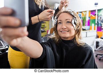 Happy Customer Talking Selfie In Beauty Salon