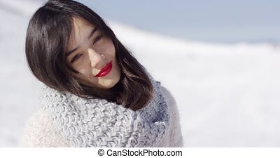 Happy cute asian girl enjoying her winter time