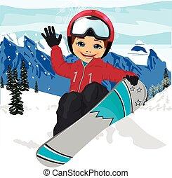 happy cute boy jumping with snowboard at ski resort