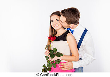 Happy cute couple in love on the date kissing each other