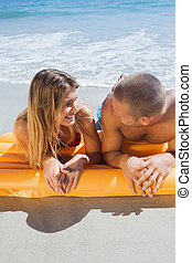 Happy cute couple in swimsuit looking at each other