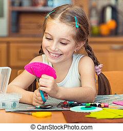 little girl is engaged in needlework - happy cute little...