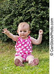 Happy cute little girl outdoor