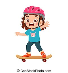 happy cute little kid girl play skateboard