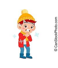 happy cute little kid play and wear jacket in winter season. child feeling chill wearing warm clothes