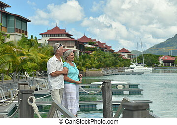 senior couple on the pier