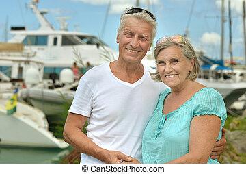 senior couple on the pier