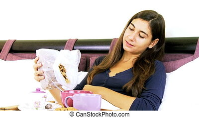 Happy cute woman eating cereals