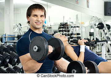 sport - happy cutie athletic girl and guy, exercise with ...