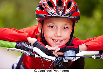 Happy cyclist - Close-up of a little boy?s face on bike...