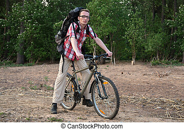 Happy cyclist on the coast