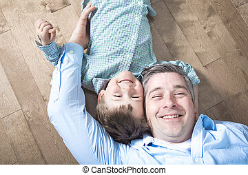 Happy dad and son. Top view of father
