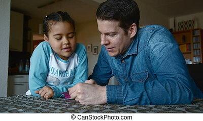 Happy dad explaining his daughter
