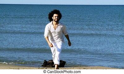 Happy dancer rehearsing on beach