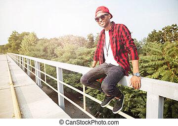 Happy dark skinned guy wearing sunglasses