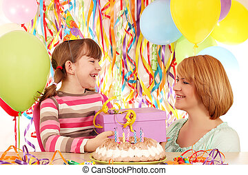 happy daughter and mother with birthday gift