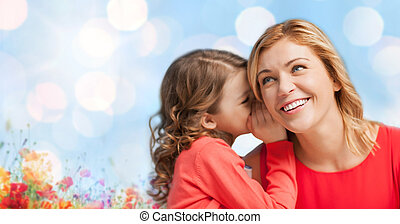 happy daughter whispering gossip to her mother