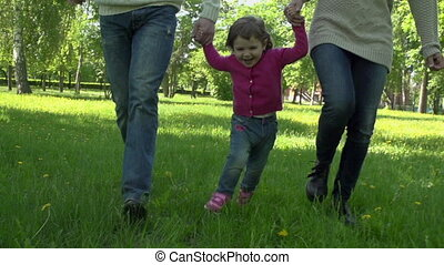 Happy Day - Low angle of family running, parents are...