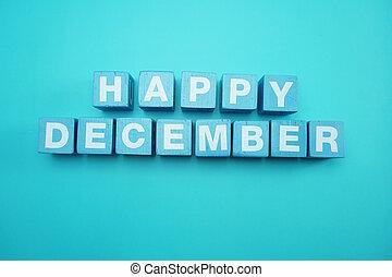 Happy December alphabet letters on blue background